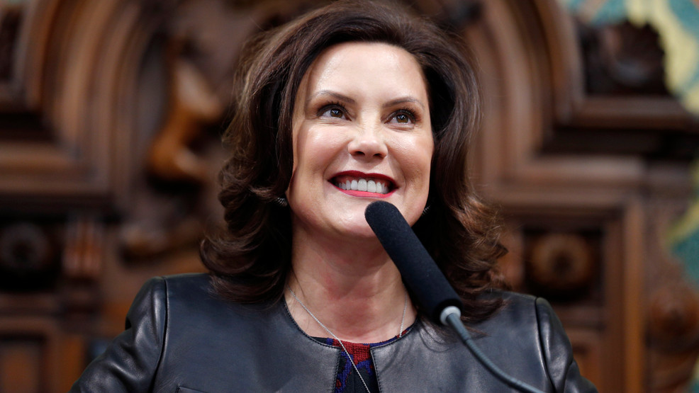 In this Jan. 29, 2020, file photo, Michigan Gov. Gretchen Whitmer delivers her State of the State address to a joint session of the House and Senate, at the state Capitol in Lansing, Michigan. (AP Photo/Al Goldis, File)